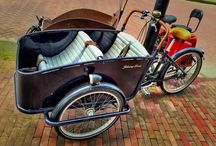 Cool bikes in Amsterdam - Bakfiets / These are freight bikes but also the ones used by parents to carry their kids throughout the city in Amsterdam.