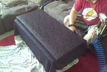 toy chest / repurposed a sofa with metal legs and snakeskin fabric we found on side of road. now it is a toy chest/sofa.