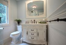 Classic Twist in Dix Hills / This is a bathroom slightly larger than most but with some real flare.  It is a functional bath complete with a glass walled shower that helps make the space seem more open.  It was adorned with some Baroque style which coordinates well with the homeowners passion for chandeliers.