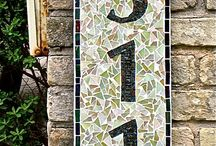 Mosaic street numbers and plaques