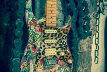 The Glamzster / Not for everyone. 80's comics and leopard on strat-style electric guitar. Glam.