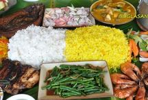 Boodle Fight / Originally it is a military style of eating where food is prepared on top of the banana leaves in a long tables and eating with the bare hands.  A unique and adventurous way of having your food than taking it in the normal way....