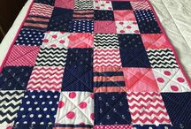 Handmade Quilts by me. / I just started quilting and absolutely love it.  If you find something you like but in different fabrics just let me know.