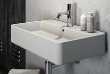 "Tratto / Linearity, elegance and lengthways development are the main elements of the new TRATTO basins range. Its name recalls the shape of a ""dash"" and its versatility permits to install all the elements in different ways: wall hanging, counter top or installed on coordinated furniture. TRATTO is the new and original line to complete your bathroom concept signed by Olympia."