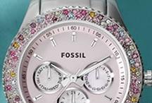 watches / by Elizabeth Calvinisti