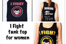 Fighter Girls Tanks & Tees / Shop fightergirls.com. The 1st & original in women's MMA. Best quality & dedicated to the female warrior. Http://www.fightergirls.com/shop. #fightergirls #wmma #womensmma #fightwear #sportswear #training #crosstrain #BodyCombat #grappling #kickboxing #jiujitsu #gym #circuttraining #boxing #muaythai #tanks #tees