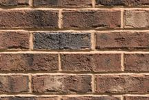 Wilmington   Triangle Brick Company / Our Wilmington brick is perfect for those looking to build something that speaks to the uncomplicated natural beauty of the Blue Ridge Parkway. A tumbled texture adds character and depth to this rustic, walnut-colored brick, featuring accent hues ranging from cream to dark gray to charcoal black. This brick is classified as a Premier tier product at Triangle Brick Company due to its combination of strength and beauty. Want a more modern brick texture? Try our Northampton brick.