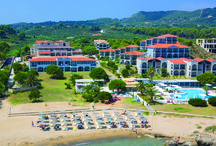 Zante - Bay Hotel & Suites / The Bay is an elegant hotel, with a modern minimalistic interior. It is located on its own private sandy beach, set in spacious grounds and surrounded by natural gardens.