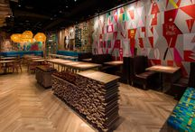 Nando's Streeterville   Restaurant Design / WoodCo was happy to help with the design of this new Nando's location. Nando's wanted a chracter grade white oak flooring milled into a herringbone pattern to fit the eclectic style of the restaurant chain. Caravel Plank was utilized in this project and adds a touch of character to the floors to accentuate the restaurant.  Photo Creds: Emilia Czader   Architect: Aria Group Architects