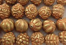 pyu jewelry and gold beads
