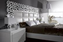 Dormitorios / dormitorios en chapa roble y nogal combinados con acero ,cristal y piel sintética.