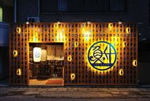"UOMASU / LSD design co., ltd. ""UOMASU""/2014/izakaya/Okinawa, Japan/interior and facade design facade design, sign design, fish, paper lantern, wood, blue"