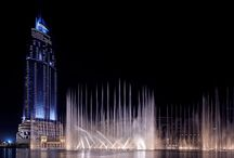 Dubai Dancing Fountain / The Dubai Dancing Fountain is the #World's #Largest at 900ft long with water jets that shoot up to 500ft in the air. A visual spectacle using 6,600 lights, 25 coloured projectors and 22,000 gallons of airborne water