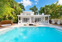 FOR SALE ~ 244 W San Marino Drive / CHARMING WATERFRONT BEACH BUNGALOW IN WHITE...SITTING ON PRIME LOCATION IN THE VENETIAN ISLANDS! Enjoy 60 Feet of Premium West Views w Magical Miami Sunsets from the Pool & oversized Private Dock on the Bay. Private Master Suite encompassing entire 2nd Floor leads to a huge covered Pergola & Terrace + sexy Master Bath with Sauna. Open Floorplan on the 1st floor flows beautifully for Entertaining with an open Kitchen & Dining area. $5,450,000 
