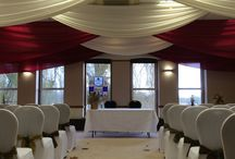 The Maltings in Ely - Festive Wedding / Warm berry red is the accent shade of choice for this winter wedding, with custom made festive chair sashes to go with our white lycra chair covers.