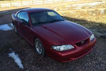 Used 1995  Ford Mustang for Sale (56151) at Pueblo, CO / Make:  Ford, Model:  Mustang, Year:  1995, Body Style:  Sports Cars, Exterior Color: Red, Interior Color: Tan, Doors: Two Door,  Vehicle Condition: Good, Engine: 8 Cylinder,Transmission: Manual, Fuel: Gasoline, Drivetrain: 2 wheel drive - rear.   Contact;814-316-1477  Car Id (56151)