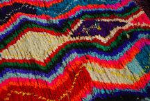 Boucherouite Rag Rugs / Boucherouite (pronounced boo-shay-REET) comes from a Moroccan Arabic phrase which means clothing that is torn and reused. The hot vivid colors and free-wheeling designs of these hand made rugs are not the only thing that makes them exciting—they represent a new shift in Berber rug making.  Ranging in size from two to nine feet in length, we now carry these rugs in our Farmville, Manassas and Raleigh, NC locations. Larger rugs begin at $249. (In Farmville, they can be found in Building One.)