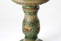 Bird Baths / Bird baths to add to your garden. We carry two different styles of decorative birdbaths, including the 24-inch floral bird bath and our 25 inch Irish bird bath. The Irish birdbath is shaped like a column and features eye-catching Celtic scrollwork. The bird bath also has an inspirational verse inscribed around the edge of the birdbath bowl. Our Floral Bird Bath, designed by Joseph's Studio, features graceful curves and colorful floral designs.