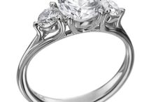Wedding Style - Three Times the Sparkle! / Symbolizing your past, present, and future, a three-stone engagement ring features a large center diamond flanked by two smaller diamonds.