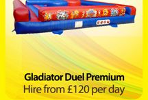 Gladiator Duel £120 per hire / Bouncy Castle Hire, Gladiator Duel Premium High action, high octane fun game for all ages.  £120 per day  £210 full weekend (Fri 18:00 - Sun 18:00) If you would like to let the party run on a little later you can keep the inflatable overnight for an additional £20. We'll come back the following morning and pick it up then!