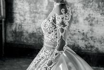 J'Aton / Australian design duo Jacob Luppino and Anthony Pittorino started J'aton Couture in 1995. The line's aesthetic is based on accentuating a woman's curves with embellishments, intricate detail and tulle. J'Aton Bride and Valentini Collection dresses are Made in Italy.
