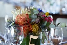Raiel and Matt's Tokara Wedding / Same Sex Wedding at Tokara Stellenbosch.  Fynbos and Protea Flowers, with Concrete, Copper and Navy.
