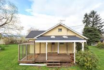 1105 W 36th Street Vancouver, WA 98660 / Super cute Bungalo with charming built-ins and woodwork! Full unfinished basement with outside entrance! Peekaboo views of the river! Side-covered deck, huge double lot zoned R­18! 1/2 an acre in town! Many possibilities here! OPEN HOUSE Saturday 3/26 from 11am-1pm!