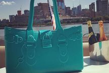 Model M. - AQUAMARINE (blue) / She's not just the 'it' bag of the season, she's a modern classic.  Fabricated of Fashion-Flex™—a proprietary polymer—Model M. withstands any fashion forecast. Model M. is stylish, resilient, light-weight, and patent-pending. The easy-to-wear construction gives the handbag a sculptural silhouette that never slouches. In seven vivid colors—Emerald, Onyx, Tourmaline, Citrine, Diamond, Topaz and Aquamarine—Model M. is a head-turner, just like you.