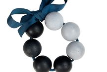 OrbisHue /  The newest addition to Konzuk, the OrbisHue Collection, picks up elements from our internationally acclaimed Orbis line but on a grander scale.  OrbisHue elegantly displays concrete spheres on colored grosgrain ribbon. The orbs are tinted in shades of grey or black, and methodically arranged by hand to create a one-of-a-kind finish. These unique motifs appear in bracelets,  in various sizes.  Classic luxury, re-defined for today.