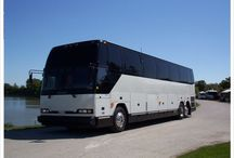 """35 Passenger Limousine Coach / Wow! The ultimate in travel. The interior of this coach is an """"open"""" concept with lots of space and beautiful captains chairs."""
