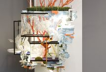 Sarah Sze / Sarah Sze is a contemporary artist known for sculpture and installation works that employ everyday objects to create multimedia landscapes. Combining domestic detritus and office supplies into fantastical miniatures, she builds her works, fractal-like, on an architectural scale.