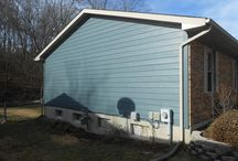 Evening Blue Siding Installation in Arnold, MO. (63010) / This is a recent job that features James Hardie Colorplus Lap Siding. It is an home improvement job with Navajo Beige Hardie Trim.