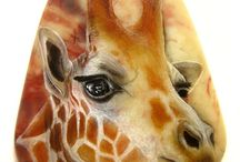 Giraffes-painted rocks