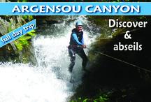 """Canyon de l'Argensou / Ce joli canyon sauvage, creusé dans les schistes rouges, est assez ouvert et aérien. Vous descendrez de nombreuses cascades peu arrosées, idéales pour apprendre la descente en rappel sur corde. La couverture végétale généreuse laisse filtrer le soleil, ce qui permet d'apprécier les """"douches"""" successives sans avoir froid. C'est un canyon a tendance verticale qui vous permettra d'apprendre à progresser sur corde. Notre objectif est que vous soyez autonome sur ce point à la fin du parcours."""