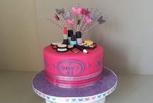 A pink and purple make up cake