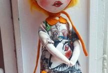 Jubaba dolls / The bodies and clothes of the Jubaba dolls are hand- made and their faces painted with acrylic paint. Their maker, Julia Wagner Fazakas, strives to make their features and eyes expressive, to make them authentic and human- like, but strikingly extraordinary at the same time. Wrinkles, beauty marks and glimmer appear on the faces, while the huge eyes truly make them dollish, surreal.