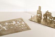 """District 1937 diorama per Ray Ban / In occasione dell'evento """"District 1937"""" organizzato per il lancio della sua ultima collezione, Ray Ban ha incaricato Microstudio di progettare un elemento in acciaio che celebrasse l'evento utilizzando uno dei materiali utilizzati per la nuova collezione."""