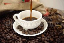 Coffee puring into white cup