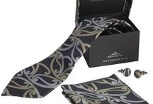 New Zealand Maori Design Ties / New Zealand Maori Design Tie Sets  Tie Set Includes: Woven Men's Neck Tie Matching Cufflinks Matching Pocket Handkerchief Quality Presentation Box with matching padded lid & silver foil Kia Kaha printed logo on front.   View them all: http://www.silverfernz.com/new_zealand_men_neck_ties.asp