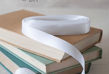 Satin Ribbons and Bows / A variety of coloured satin ribbons and bows perfect for DIY wedding and crafting projects.