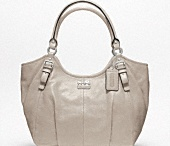 Handbags! / Some of my favorite handbags including Coach, Gucci and Prada! / by Kimberly Riley
