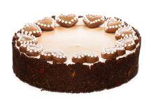 Perníkový cheesecake / Smyslná chuť kakaového korpusu a krémového sýru Philadelphia v kombinaci s voňavým perníkovým kořením. Dozdobený domácími Ollies perníčky.