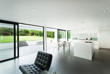 Indoor Outdoor / Major renovation of this 1970s family home necessitated a contemporary kitchen to complement the style of the new extension.  Working with both the client and the architect, the requirement was to design a bright and sleek kitchen that would maximise the garden views and allow a natural overflow from inside to outside.