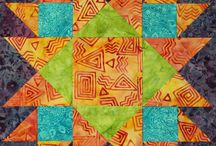 BlockBusters / The blocks from my BlockBuster series, they're downloadable documents with instructions for creating blocks that can be make in a range of sizes using your Studio 180 Design tools. The blocks are shown with multiple fabric styles, so you can see that the same block works in many different fabrics. With the different blocks you can make a sampler quilt or just add them to your block library, they are here for you to enjoy and use how you will!