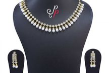 Simple and Elegant Pearl Choker in White Oval Pearls at Rs.3900