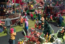 Lemax 2015 Summer/Autumn Carnival in the Park / This is a carnival I have set up on an 8ft x 9ft (240cm x 270cm) board featuring all the rides, stalls and Carnival related figurines in the Lemax 2015 range. This display has 12 major rides, 14 stalls, 25 trees, 150 flowering bushes, 250+ figurines and took about 130 hours of construction/setting up time. The grass is hand laid  Noch Summer/Spring 2.5mm random mix, roadway is painted with paint/glue and coarse sand mix to give it texture. Display since dismantled! Enjoy!