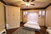 Murphy Beds / Wall beds tuck right into a cabinet, saving space and doubling the function of the room. Contact us for a custom Murphy bed design for your home!