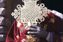 Ethiopian, coptic procession crosses / This board shows, Ethiopian coptic procession crosses in all kind of materal, and what the church dignitaties wear during their ceremonies.
