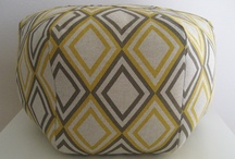 I love poufs / Lately, poufs are everywhere... and they should be. Perfect for a footrest, or extra seating for a crowd. A fun way to bring in some texture, a round shape, or some pattern. I say, hooray for poufs!