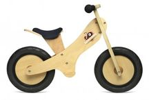 """Kinderfeets Balance Bike / Derived from the Dutch for """"children"""" and """"bicycle,"""" a Kinderfeets is a wooden balance bike designed to ease the transition to pedal-powered bicycle at a toddler's comfort level."""